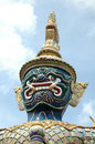 Grand palace mythical giant statue stands guard at the wat phra kaeo in bangkok thailand Royalty Free Stock Photo
