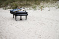 Grand piano on the beach standing in sand Stock Photography