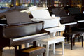 Grand pianos a row of different color Royalty Free Stock Photo