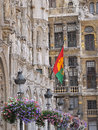 Grand place in brussels flag of with city hall and guild houses on Royalty Free Stock Image
