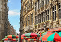 Grand place in brussels historical medieval buildings and umbrellas on clear summer day Stock Photos