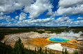 Grand prismatic pool yellowstone national park at with blue sky and puffy clouds Royalty Free Stock Photos