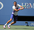 Grand Slam champion Marin Cilic of Croatia in action during his round 4 match at US Open 2015 at National Tennis Center Royalty Free Stock Photo