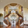 The curved dual grand staircase in an upscale home. Royalty Free Stock Photo