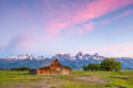 Grand teton mountains wyoming vintage barn sits in front of the Stock Photo