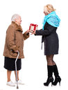 Grandaughter giving gift to her grandmother Royalty Free Stock Photo