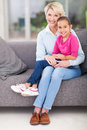 Granddaughter grandma lap cute little sitting on s at home Stock Images