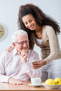 Grandfather and adult granddaughter spending time together Royalty Free Stock Photo