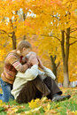 Grandfather with boy resting in autumn park closes s eyes Royalty Free Stock Image