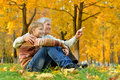 Grandfather with boy resting in autumn park closes s eyes Royalty Free Stock Photos
