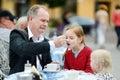 Grandfather feeding frothy milk to his grandchild Royalty Free Stock Photo