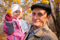 Grandfather with  granddaughter on autumn Stock Photo