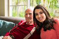 Grandfather and granddaughter elderly eighty plus year old men with in a home setting Royalty Free Stock Photos