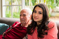 Grandfather and granddaughter elderly eighty plus year old men with in a home setting Royalty Free Stock Photography