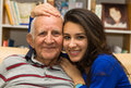 Grandfather and granddaughter elderly eighty plus year old men with in a home setting Stock Images