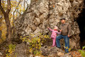 Grandfather and granddaughter are near the cavern Stock Image
