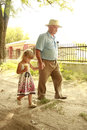Grandfather and granddaughter are on the road a Stock Photography