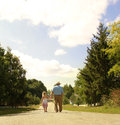 Grandfather and granddaughter are on the road a Stock Photos