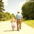 Grandfather and granddaughter are on the road a Stock Photo