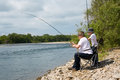 Grandfather and grandson go fishing Royalty Free Stock Photos
