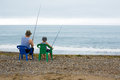 Grandfather and grandson go fishing Stock Photos