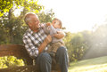 Grandfather with grandson in park playful spending time his Stock Image
