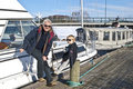 Grandfather and grandson on the pier. Royalty Free Stock Photography