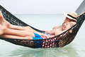 Grandfather and grandson relaxing in beach hammock asleep Royalty Free Stock Photo