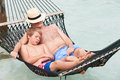 Grandfather and grandson relaxing in beach hammock asleep Royalty Free Stock Image