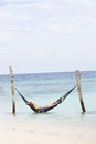 Grandfather and grandson relaxing in beach hammock the sea Royalty Free Stock Photos