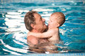 Grandfather and grandson swim Royalty Free Stock Image