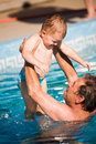 Grandfather and grandson swim Stock Photos