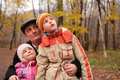 Grandfather with grandsons in forest Stock Photos