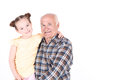 Grandfather with his grand daughter portrait of a pretty small girl wearing yellow top and her loving wearing checkered shirt Royalty Free Stock Images