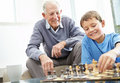 Grandfather and his grandson playing chess Royalty Free Stock Images
