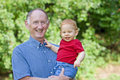 Grandfather holding baby Royalty Free Stock Photos