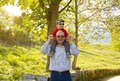 Grandfather holding grandchild on his shoulders happiness in front of a tree Stock Photography