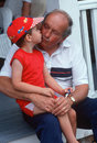 Grandfather kissing grandson on porch Royalty Free Stock Photo
