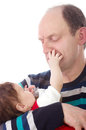Grandfather with newborn baby girl laughing Stock Photo