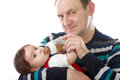Grandfather with newborn baby girl laughing Royalty Free Stock Image