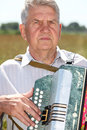 Grandfather play on accordion Royalty Free Stock Photography