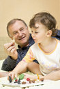 Grandfather playing with granddaughter Royalty Free Stock Photo