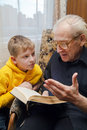 Grandfather Reading To His Grandson Royalty Free Stock Photography