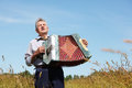 Grandfather in shirt hold, play on accordion Stock Photography