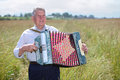 Grandfather in shirt play on accordion Royalty Free Stock Photos