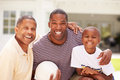 Grandfather With Son And Grandson Playing Volleyball Royalty Free Stock Photo
