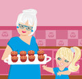Grandma baking cookies with her granddaughter Royalty Free Stock Photo
