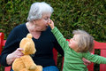 Grandma and grandchild having fun in the garden Royalty Free Stock Photos