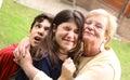 Grandma with grandchildren close up cuddle photo Royalty Free Stock Photo