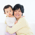Grandma and granddaughter asian family portrait grandchild indoor living lifestyle at home Stock Photography